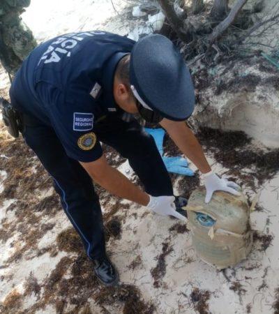 Policía Federal y Marina aseguran paquete de droga que recaló en la playa del Moon Palace