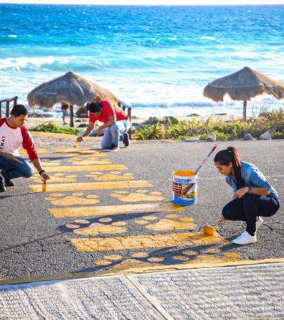 Pintan pasos peatonales en la carretera Mar Caribe para seguridad de bañistas de Isla Mujeres