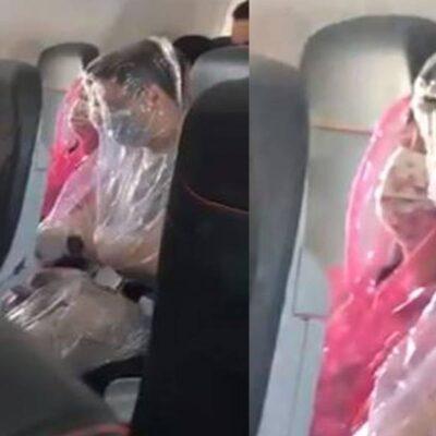VIDEO | Pareja de pasajeros vuelan envueltos en plástico para evadir al coronavirus