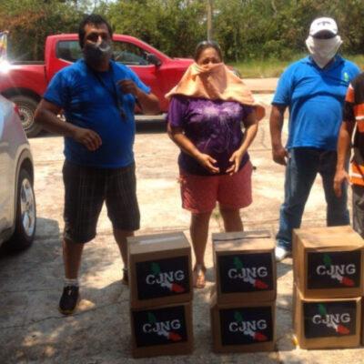 VIDEOS | Veracruzanos hacen fila para recibir despensas del CJNG