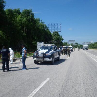 TIRAN A ENSABANADO EN PUERTO MORELOS: Hallan cadáver a orilla de la carretera entre Cancún y Playa